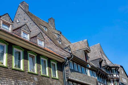 Goslar, Germany - July 08, 2018: Facade of a building made of natural slate tiles Redactioneel