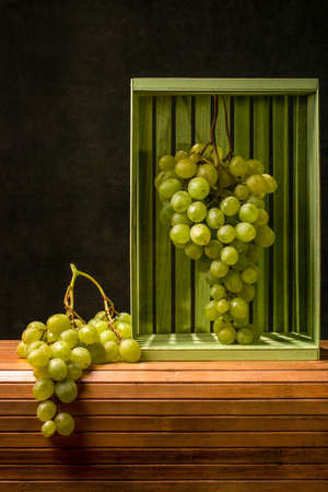 Still life with ripe large bunches of grapes