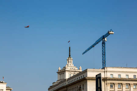Sofia, Bulgaria - August 09, 2017: Airplane and crane over the building of Soseta of Ministers of Bulgaria in Sofia Sajtókép