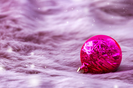 pink fur: Beautiful xmas ornaments on pink fur background with space for text. Merry christmas card.