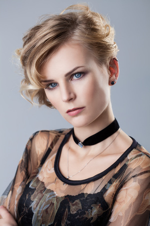 studio portrait of a young blonde woman Stock Photo