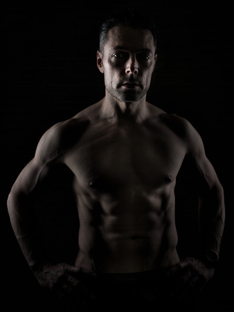 40: fit man over 40 on dark background