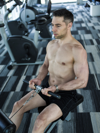 sixpack: fit man over 40 working out in gym Stock Photo