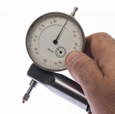 depth gauge: Digital indicator in hand for precise measurement Stock Photo