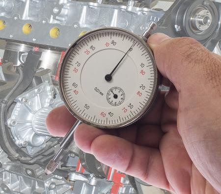 depth gauge: Digital indicator in hand for precise measurement Stock Photo