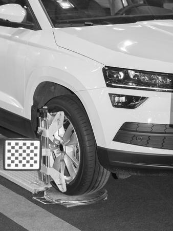 Wheel alignment equipment in a car repair station Banco de Imagens
