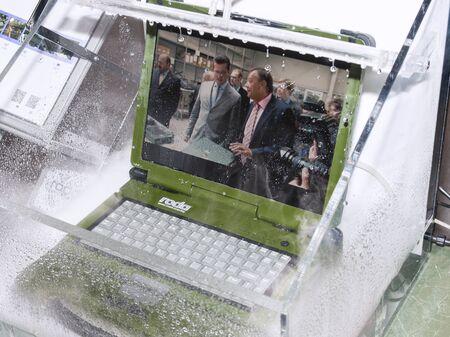 Ukraine. October 12, 2018. New development of computer engineers waterproof laptop in a box with water