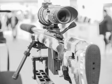 Close-up rifle with optical sight and stand
