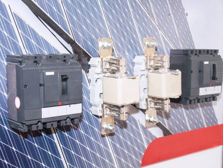 Electric fuses and toggle switches to turn on the voltage against the background of solar panels