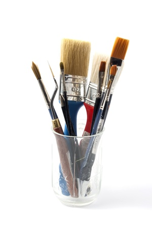 Paintbrushes on a jar isolated on white background Фото со стока