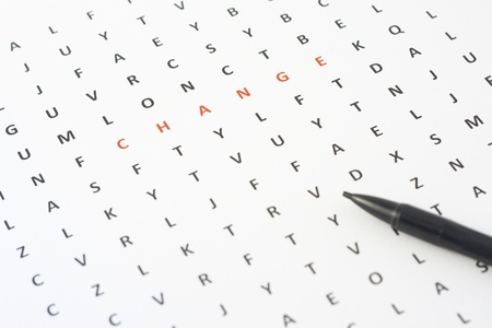 Word change among different letters on a sheet paper Stock Photo - 16041044