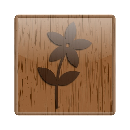 Shiny icon with flower design on wooden background photo