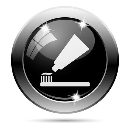 fluoride toothpaste: Metallic round glossy icon with white design on black background Stock Photo