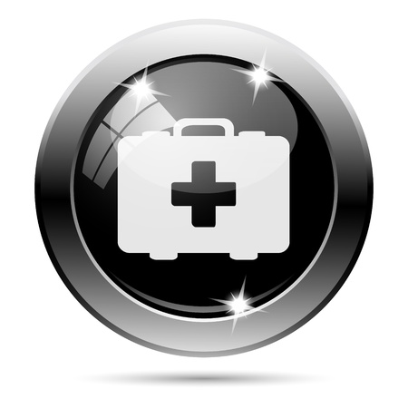 first aid kit key: Metallic round glossy icon with white design on black background Stock Photo
