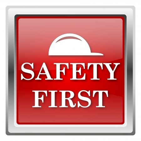 safety first: Metallic icon with white design on red background Stock Photo