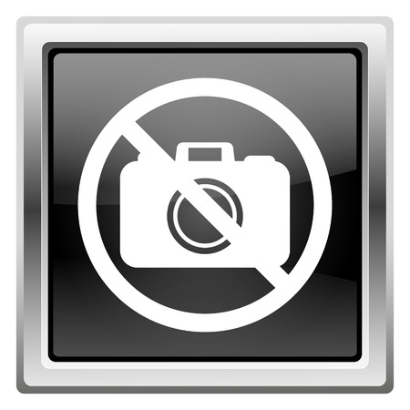 Metallic icon with white design on black background photo