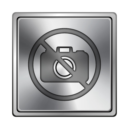 Square metallic icon with carved design on grey background Stock Photo - 24162156