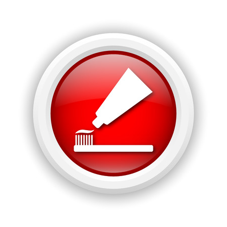 fluoride toothpaste: Round plastic icon with white design on red background