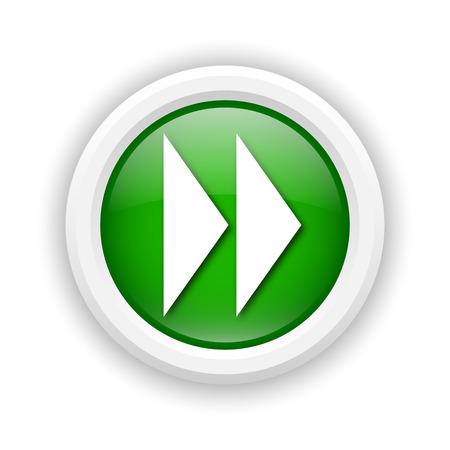 rewind icon: Round plastic icon with white design on green background