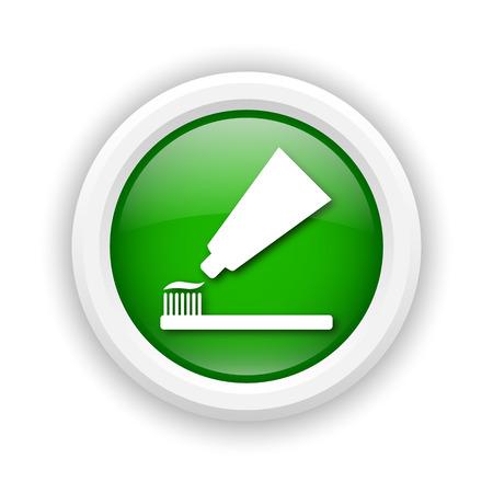 fluoride: Round plastic icon with white design on green background