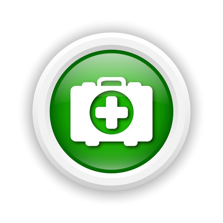 first aid kit key: Round plastic icon with white design on green background
