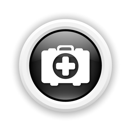 first aid kit key: Round plastic icon with white design on black background