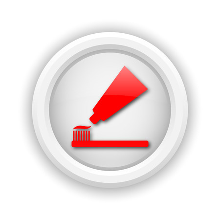 fluoride: Round plastic icon with red design on white background