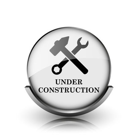 Under construction icon. Shiny glossy internet button on white background.  photo