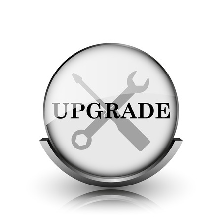 Upgrade icon. Shiny glossy internet button on white background.  photo