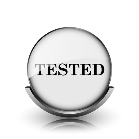 Tested icon. Shiny glossy internet button on white background.  photo