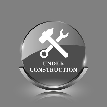 Under construction icon. Shiny glossy internet button on grey background.  photo