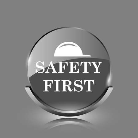 cautionary: Safety first icon. Shiny glossy internet button on grey background.