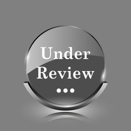 Under review icon. Shiny glossy internet button on grey background.  photo