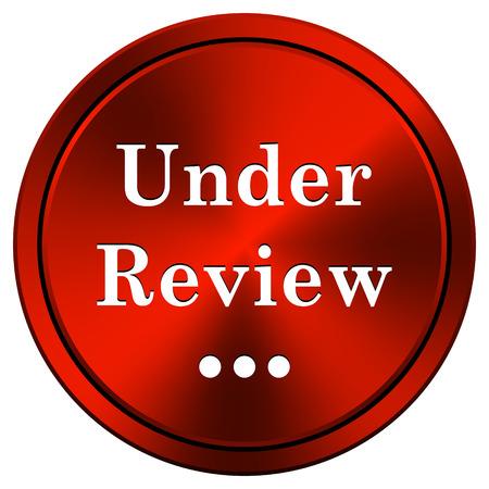 Under review Red metallic round icon on white background photo