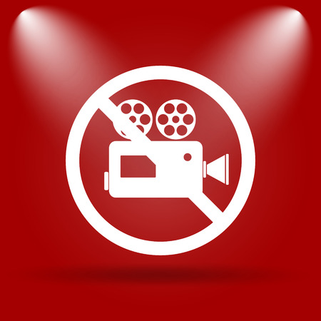 Forbidden video camera icon. Flat icon on red background. photo