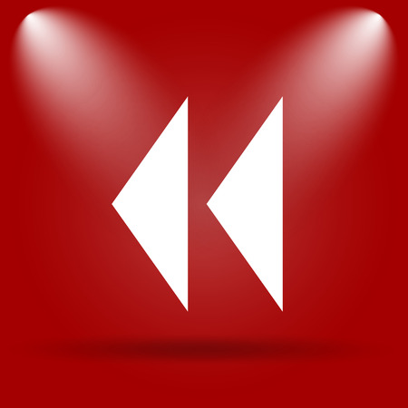 Rewind icon. Flat icon on red background. photo