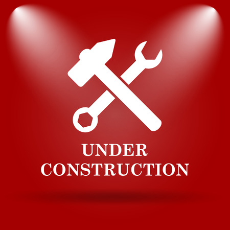 Under construction icon. Flat icon on red background. photo