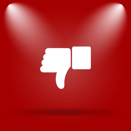 thumb down icon: Thumb down icon. Flat icon on red background. Stock Photo