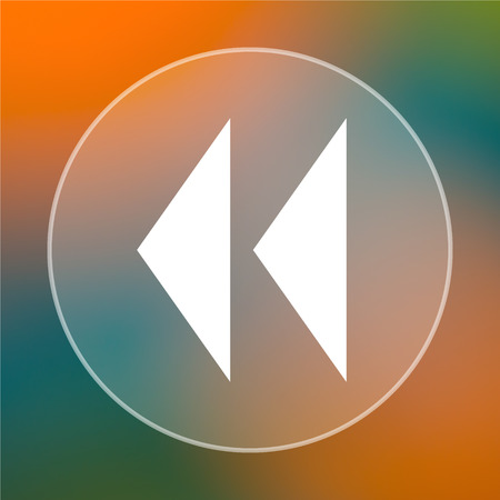 rewind icon: Rewind icon. Internet button on colored  background. Stock Photo