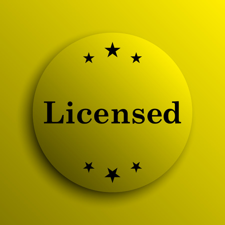 licensed: Licensed icon. Yellow internet button. Stock Photo