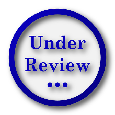 canceled: Under review icon. Blue internet button on white background. Stock Photo