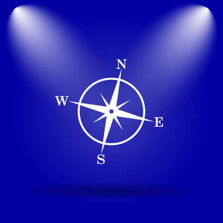 Compass icon. Flat icon on blue background. photo