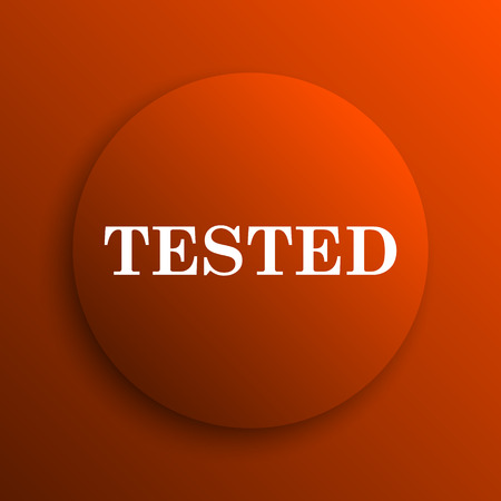 tested: Tested icon. Internet button on orange background Stock Photo