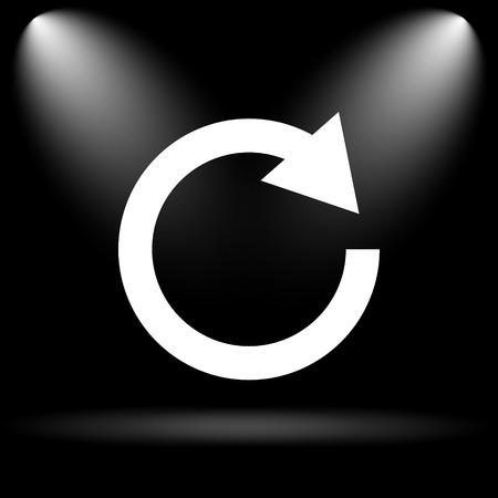 black button: Reload one arrow icon. Internet button on black background. Stock Photo