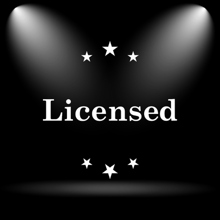licensed: Licensed icon. Internet button on black background. Stock Photo
