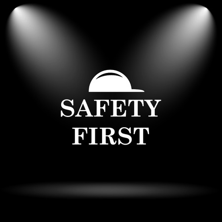 Safety first icon. Internet button on black background. Stock Photo