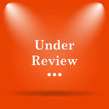 rejection: Under review icon. Internet button on orange background. Stock Photo