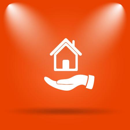 hand holding house: Hand holding house icon. Internet button on orange background.