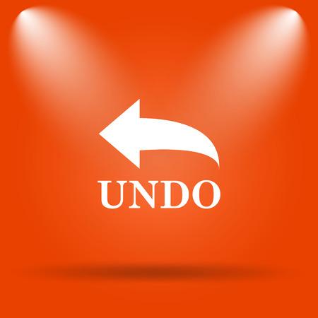 undo: Undo icon. Internet button on orange background.