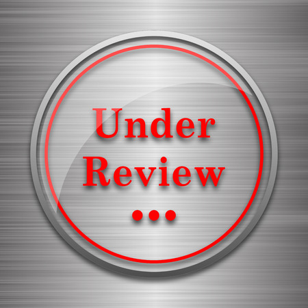reviewed: Under review icon. Internet button on metallic background. Stock Photo